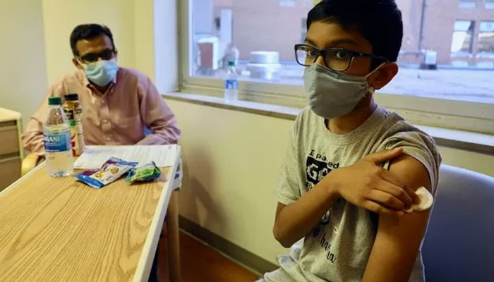 All public schools in Los Angeles have been directed to ensure that children aged 12 and above are fully vaccinated against coronavirus. AFP