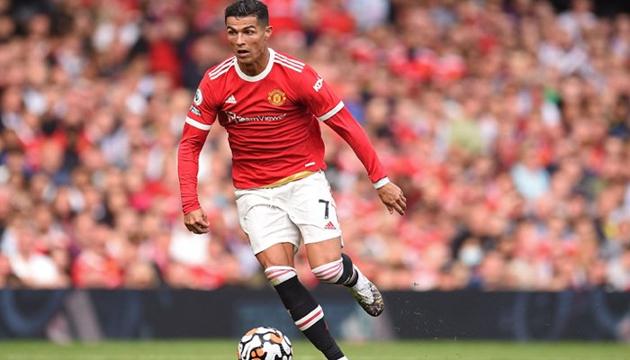 Manchester United´s Portuguese striker Cristiano Ronaldo runs with the ball during the English Premier League football match between Manchester United and Newcastle at Old Trafford in Manchester, north west England, on September 11, 2021. — AFP
