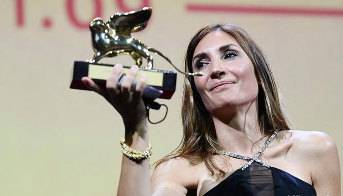 Director of the abortion Happening Audrey Diwan shows her Golden Lion award for Best Film at the 78th Venice Film Festival. AFP