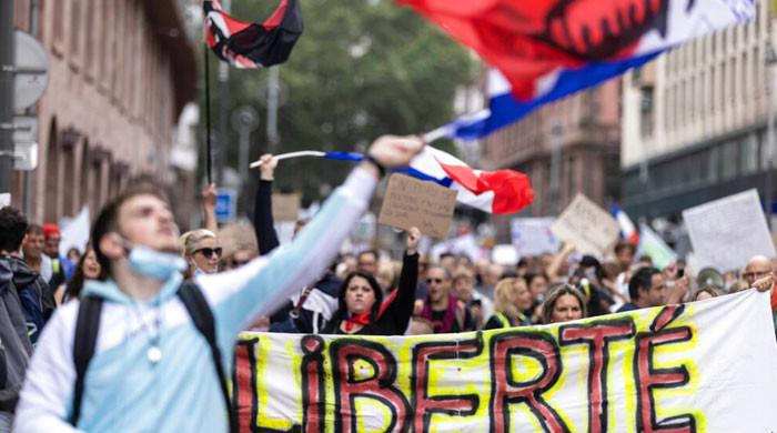 Thousands protest against mandatory Covid-19 health pass in France