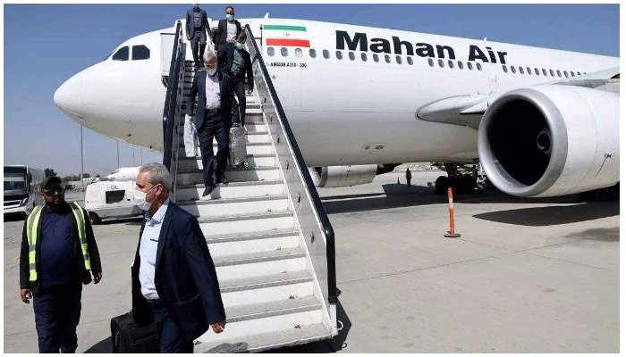 Passengers get off a Mahan Air flight at the airport in Kabul on September 15. Photo AFP