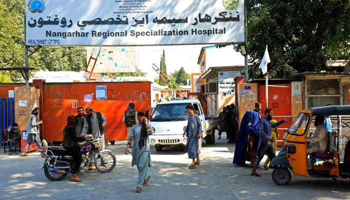 Afghan people are pictured outside the Nangarhar Regional Specialization Hospital after explosions in Jalalabad on September 18, 2021, as at least two people were killed and up to 20 more wounded in three explosions, a Taliban official said. — AFP