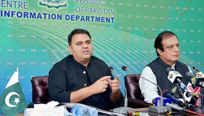 Federal Minister for Information and Broadcasting Fawad Chaudhry (L) and Minister for Science and Technology Shibli Faraz, addressing a press conference at Press Information Department, Islamabad, on September 19, 2021. — PID