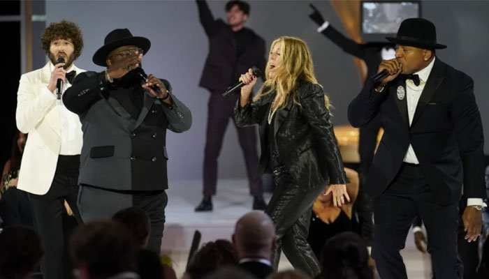 Scaled-down in-person Emmys kick-off with group musical number