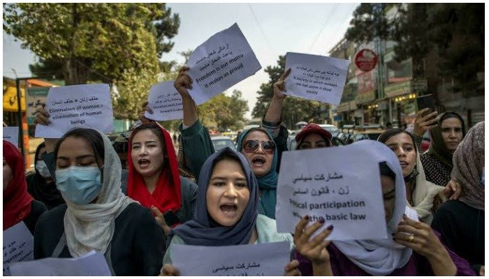 About a dozen Afghan women protested briefly Sunday outside the old Ministry for Womens Affairs, which has now been replaced by a department that earned notoriety for enforcing strict islamic doctrine — AFP