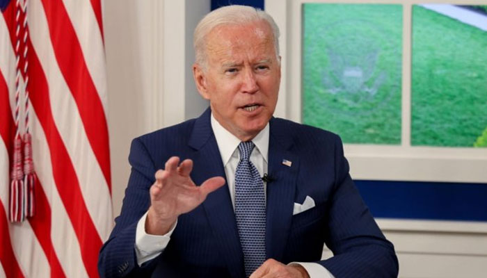US President Biden addressing a virtual Covid-19 summit from White House. AFP