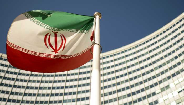 An Iranian flag flutters outside of the UN headquarters during the opening of the International Atomic Energy Agency (IAEA) Board of Governors meeting in Vienna, Austria, on September 10, 2018. —Joe Klamar/AFP |