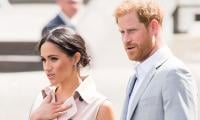 Meghan Markle, Prince Harry 'to Reconsider' UK Christening Over Mounting Pressure