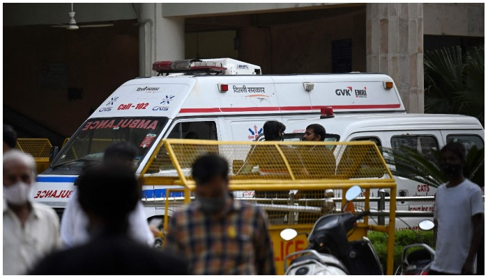 An ambulance is seen inside the Rohini court in New Delhi on September 24, 2021, after a notorious Indian gangster was killed by gunmen dressed as lawyers in a bloody shootout in a courtroom where three people died, local media reported. — Photo by Money Sharma/AFP