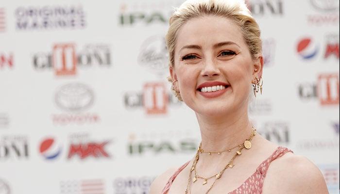 Amber Heard flexes multi-tasking skills as a new mother