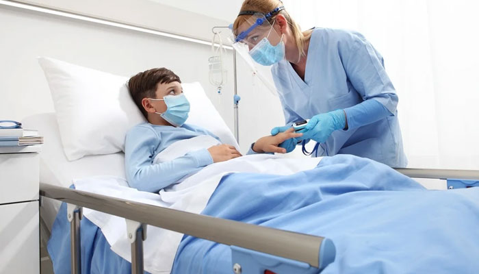 A child affected with coronavirus is being treated at a hospital. File photo