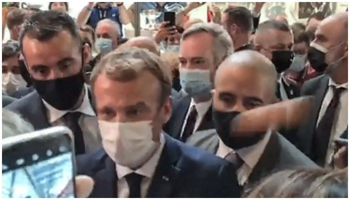 This video grab made from a footage by LyonMag.com shows an egg bouncing on French President Emmanuel Macron´s shoulder — AFP