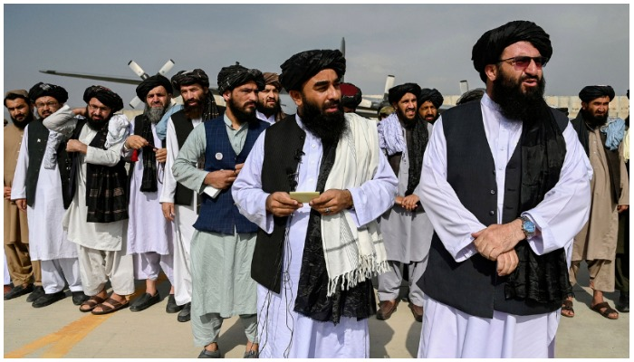 Taliban officials stand on the tarmac of Kabul airport after the withdrawal of US troops from Afghanistan. — AFP