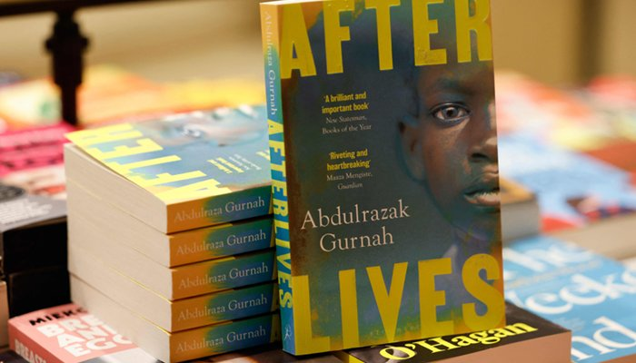 Copies of Afterlives by Tanzanian-born novelist Abdulrazak Gurnah are displayed at Waterstones bookshop in central London on October 7, 2021.