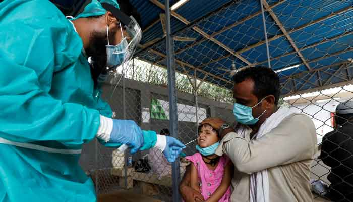 A healthcare worker collecting sample for COVID-19 test. File photo