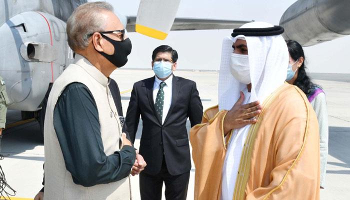 UAE Minister of Justice Abdullah bin Sultan bin Awad Al Nuaimi welcomes President Dr. Arif Alvi at Dubai airport. Photo: PID
