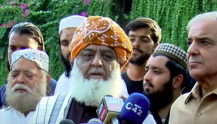 PDM chief Maulana Fazlur Rehman (centre) and Leader of the Opposition in the National Assembly Shahbaz Sharif (eight) addressing a press conference in Lahore on October 10, 2021. — YouTube/HumNewsLive