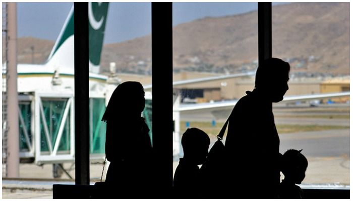 Passengers leave to board on a Pakistan International Airlines plane at the airport in Kabul, Afghanistan, on September 13, 2021. (AFP/File)