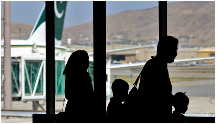 Passengers leave to board on a Pakistan International Airlines plane at the airport in Kabul, Afghanistan, on September 13, 2021. Photo — AFP