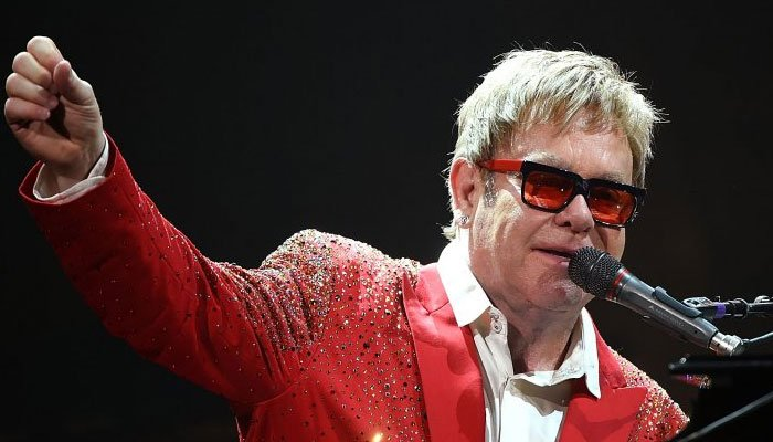 Elton John beats Elvis, Cliff Richard and Michael Jackson to become first with UK Top 10 singles