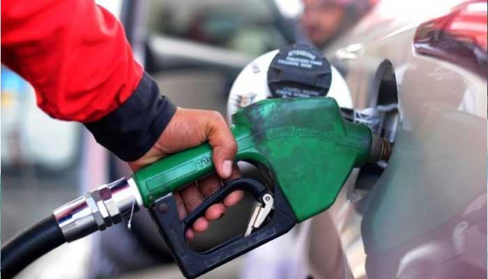 A staff member of a pumping station in Pakistan fills up a car with fuel. — AFP/File