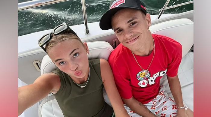 Victoria Beckham's son Romeo and his girlfriend Mia Regan share loved up snaps from boat
