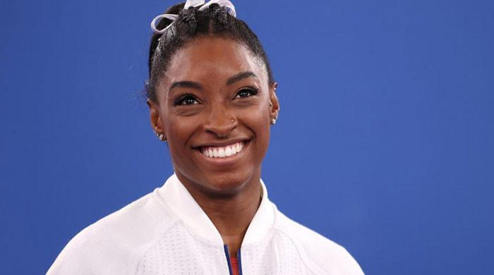 Simone Biles celebrates the 'courage' to 'put herself first'