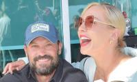 Brian Austin Green, Sharna Burgess 'live up' to year of togetherness