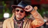 Johnny Depp Cuts A Dapper Figure During A Promotion Of His New TV Series Puffins